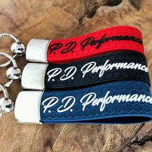Foto Kľúčenka s logom P.D.Performance Black/Red/Blue